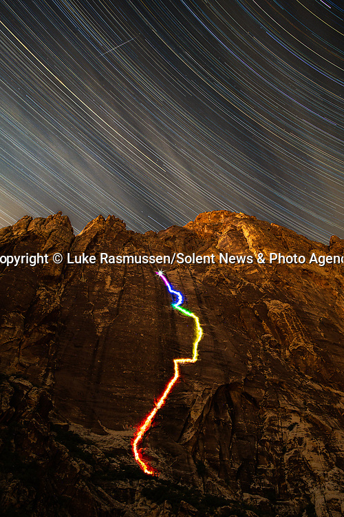 """Pictured:  A 51 minutes 30 seconds exposure at Black Velvet Canyon, Las Vegas, NV<br /> <br /> Bright bolts of colourful light snake their way across mountains and cliffs.  The striking images were created by a rock climber who wrapped LED lights around his body before capturing long exposure shots of his route.<br /> <br /> Luke Rasmussen took the photos in the deserts of Nevada, in the United States, and admits that his method of 'freezing time in a moment' is unusual.  The 28 year old photographer said: """"Wearing a sweater full of lights and climbing through the darkness of night is certainly a different experience than most climbers will get.  SEE OUR COPY FOR DETAILS.<br /> <br /> Please byline: Luke Rasmussen/Solent News<br /> <br /> © Luke Rasmussen/Solent News & Photo Agency<br /> UK +44 (0) 2380 458800"""