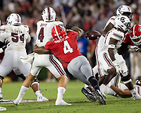 ATHENS, GA - SEPTEMBER 18: Nolan Smith #4 knocks the ball out of the hand of Luke Doty #4 before a game between South Carolina Gamecocks and Georgia Bulldogs at Sanford Stadium on September 18, 2021 in Athens, Georgia.