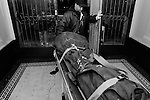 BROOKLYN -- DECEMBER 29, 2004: The body of Luciano Yevenes is removed from his building, where he was stabbed to death in a person dispute, on December 29, 2004 in the 77th Precinct of Brooklyn. While murders are down again in New York this year, hot spots persist, and the 77th is among the top 10. (PHOTOGRAPH BY MICHAEL NAGLE).