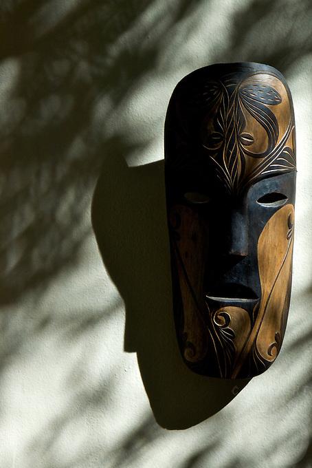 Spa decor,  a mask on the wall with shadows BORACAY ISLAND PHILIPPINES