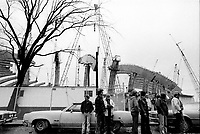 October 20, 1975 File photo -Workers walk out<br />  from the construction site of the Montreal Olympic stadium in one of the may strikes that plagued the project