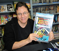 "Richard Hatch Signs ""Death Of Apollo"" Comic Book"