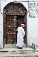 Zanzibar, Tanzania.  Mosque Entrance in Stone Town.  The door is carved in the South Asian style, with rounded top.