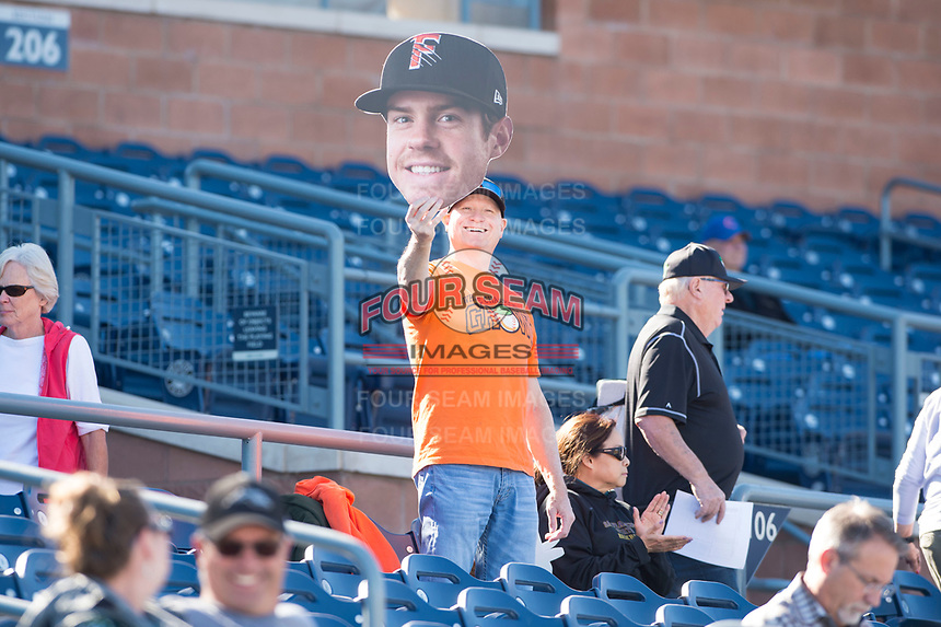 A fan holds a big head cutout of Scottsdale Scorpions center fielder Drew Ferguson (18), of the Houston Astros organization, during an Arizona Fall League game against the Peoria Javelinas at Peoria Sports Complex on November 15, 2018 in Mesa, Arizona. Peoria defeated Scottsdale 2-1. (Zachary Lucy/Four Seam Images)