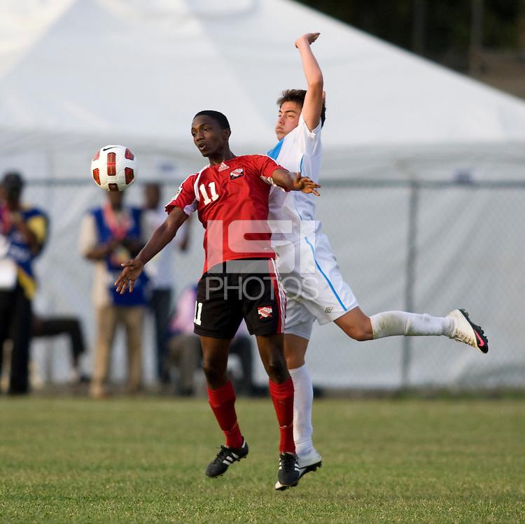 Julio Ortiz (5) of Guatemala stays close to Garvin Samaroo (11) of Trinidad & Tobago  during the group stage of the CONCACAF Men's Under 17 Championship at Jarrett Park in Montego Bay, Jamaica. Trinidad & Tobago defeated Guatemala, 1-0.