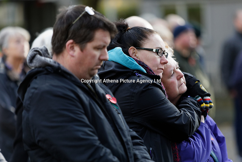 Pictured: Two women embrace as they observe two minutes silence at Castle Square Gardens in Swansea, Wales, UK. Monday 11 November 2019<br /> Re: Armistice Day, a service to commemorate those who lost their lives in conflict has been held at Castle Square Gardens in Swansea, Wales, UK.
