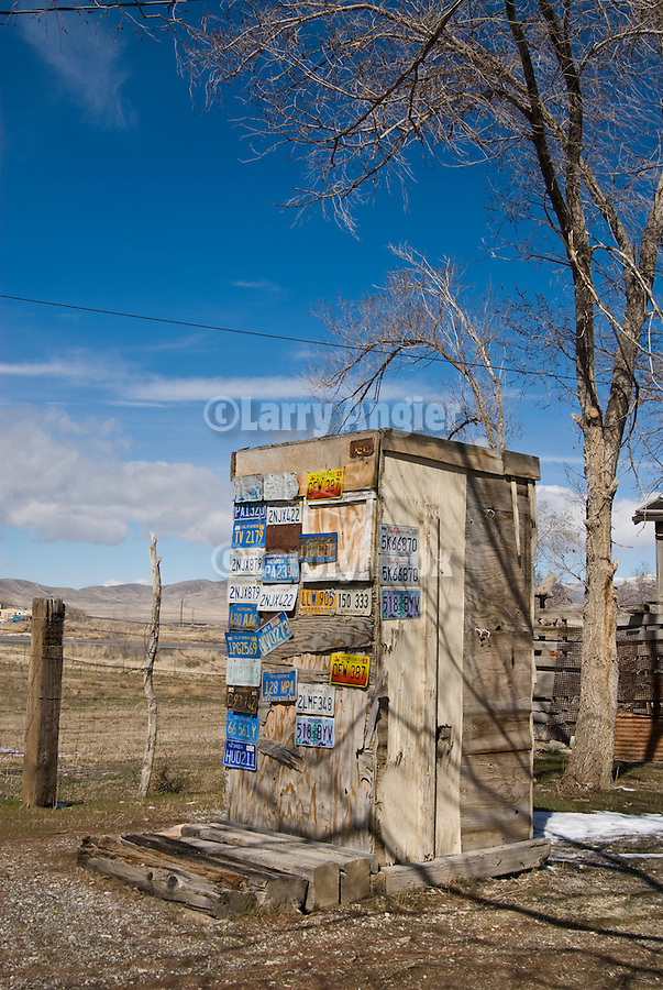 License plate covered outhouse at Thunder Mountain along I-80 in western Nevada