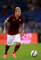Calcio, amichevole Roma vs Fenerbahce. Roma, stadio Olimpico, 19 agosto 2014.<br /> Roma midfielder Radja Nainggolan, of Belgium, in action during the friendly match between AS Roma and Fenerbahce at Rome's Olympic stadium, 19 August 2014.<br /> UPDATE IMAGES PRESS/Isabella Bonotto