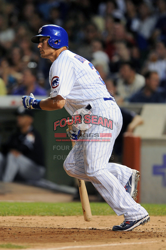 Chicago Cubs pinch hitter Jeff Baker #3 homers during a game against the Miami Marlins at Wrigley Field on July 17, 2012 in Chicago, Illinois. The Marlins defeated the Cubs 9-5. (Tony Farlow/Four Seam Images).