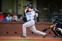 Pensacola Blue Wahoos designated hitter Devin Mesoraco (39) follows through on a swing in front of catcher Francisco Arcia (32) during a game against the Mobile BayBears on April 25, 2017 at Hank Aaron Stadium in Mobile, Alabama.  Mobile defeated Pensacola 3-0.  (Mike Janes/Four Seam Images)