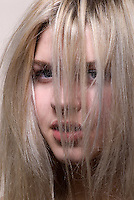 Beauty photo of blonde woman with her hair in front of her face