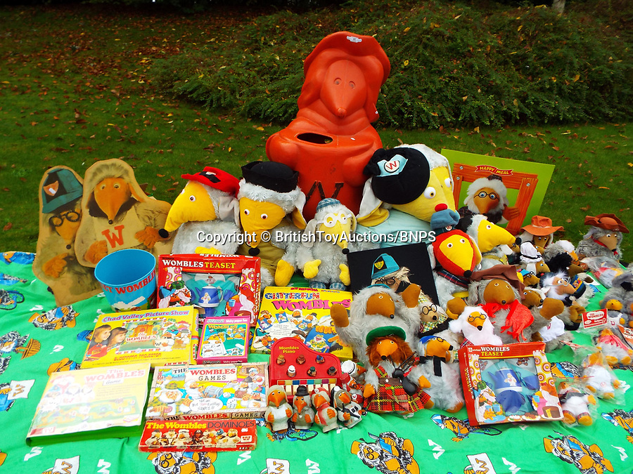 BNPS.co.uk (01202 558833)<br /> Pic: BritishToyAuctions/BNPS<br /> <br /> Some Womble items up for auction.<br /> <br /> An environmentalist is selling the world's biggest Womble collection after the famous furry creatures inspired her to save the planet as a child.<br /> <br /> Gill Seyfang, a senior lecturer in Sustainable Consumption at the University of East Anglia, owns over 1,700 items relating the furry creatures.<br /> <br /> Her vast collection ranges from soft toys to rubbish bins and was recognised by the Guinness Book of Records in 2016.