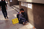 Economic crisis unemployed parent with child begging, Buenos Aires Argentina South America 2000s 2002