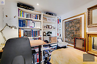 BNPS.co.uk (01202) 558833. <br /> Pic: OrlandoReid/BNPS<br /> <br /> Pictured: Study. <br /> <br /> A flat in a ten-storey Art Deco mansion block that was the fictional home of TV detective Hercule Poirot has gone up for rent for £1,950 a month.<br /> <br /> Grade II listed Florin Court in East London was used for filming the long-running ITV series about Agatha Christie's iconic detective.<br /> <br /> The one-bedroom ground floor flat includes a double bedroom, an open plan reception room and kitchen, and a study or home office and<br /> a marble-tiled family bathroom.<br /> <br /> The exterior of the building has strong Art Deco motifs, many of which were used in the filming of Poirot, for 24 years, from 1989 to 2013.