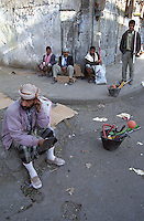 As people flee rural poverty unemployment has become a huge problem in Yemen's urban centres. These jobless men are gathered with the tools of their trade on a street corner in Sana'a where they hope to be hired for a days work.
