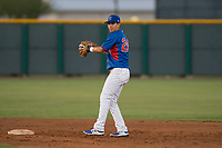 AZL Cubs 2 second baseman Reivaj Garcia (24) prepares to make a throw to first base during an Arizona League game against the AZL Reds at Sloan Park on June 18, 2018 in Mesa, Arizona. AZL Cubs 2 defeated the AZL Reds 4-3. (Zachary Lucy/Four Seam Images)