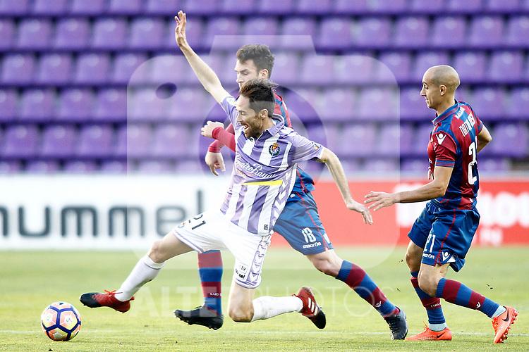 Real Valladolid's Michel Herrero (l) and Levante UD's Victor Casadesus (c) and Natxo Insa during La Liga Second Division match. March 11,2017. (ALTERPHOTOS/Acero)