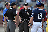 Asheville Tourists general manager Larry Hawkins first base umpire Matt Carlyon, home plate umpire Ryan Powers, Tourists manager Warren Schaeffer (13) and Hagerstown Suns manager Patrick Anderson (22) during a game against the Hagerstown Suns at McCormick Field on April 28, 2016 in Asheville, North Carolina. The Tourists were leading the Suns 6-5 when the game was delayed in the top of the 6th inning due to darkness. (Tony Farlow/Four Seam Images)