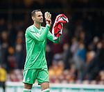 Joe Lewis applauds the Aberdeen fans