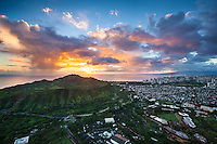 An aerial view of O'ahu's Diamond Head, Kapi'olani Community College and the Hawai'i Film Studio during a beautiful sunset, with Waikiki in the distance on the right.
