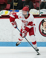 BOSTON, MA - JANUARY 11: Alex Allan #2 of Boston University passes the puck during a game between Providence College and Boston University at Walter Brown Arena on January 11, 2020 in Boston, Massachusetts.