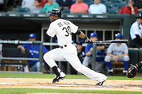 Chicago White Sox outfielder Alejandro De Aza (30) at bat during a game against the Toronto Blue Jays on August 15, 2014 at U.S. Cellular Field in Chicago, Illinois.  Chicago defeated Toronto 11-5.  (Mike Janes/Four Seam Images)