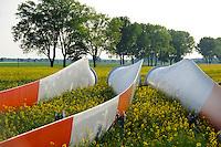 GERMANY Plauerhagen, installation of ENO Windturbine for windfarm of MVV Mannheim, rotor blades in rape seed field / DEUTSCHLAND Mecklenburg Vorpommern, Windpark Plauerhagen, Aufbau von 8 ENO 82  Windkraftanlagen mit 2 MW Nennleistung durch E.N.O energy systems GmbH Rostock fuer Windpark der MVV Stadtwerke Mannheim, Rotorblaetter im Rapsfeld