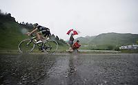 Pierre-Luc Perichon (FRA/Fortuneo-Vital Concept) over the top of the Col de Joux Plane (HC/1691m/11.6km/8.5%) and starting his descent towards the finish in horrendous conditions<br /> <br /> Stage 20: Megève › Morzine (146.5km)<br /> 103rd Tour de France 2016