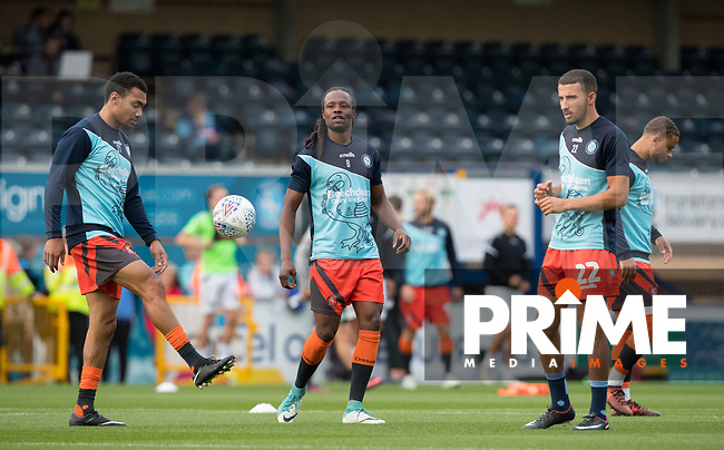 Marcus Bean of Wycombe Wanderers and teammates warm up during the Carabao Cup 2nd round match between Wycombe Wanderers and Forest Green Rovers at Adams Park, High Wycombe, England on 28 August 2018. Photo by Andy Rowland.