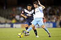 MELBOURNE, AUSTRALIA - FEBRUARY 18, 2010: Terry McFlynn from Sydney FC is tackled by Carlos Hernandez in the first leg of the A-League Major Semi Final match between the Melbourne Victory and Sydney FC at Etihad Stadium on February 18, 2010 in Melbourne, Australia. Photo Sydney Low www.syd-low.com