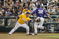 LSU Tigers Chris Chinea (26) records a putout before TCU Horned Frogs Jeremie Fagnan (32) reaches first base in Game 10 of the NCAA College World Series on June 18, 2015 at TD Ameritrade Park in Omaha, Nebraska. TCU defeated the Tigers 8-4, eliminating LSU from the tournament. (Andrew Woolley/Four Seam Images)