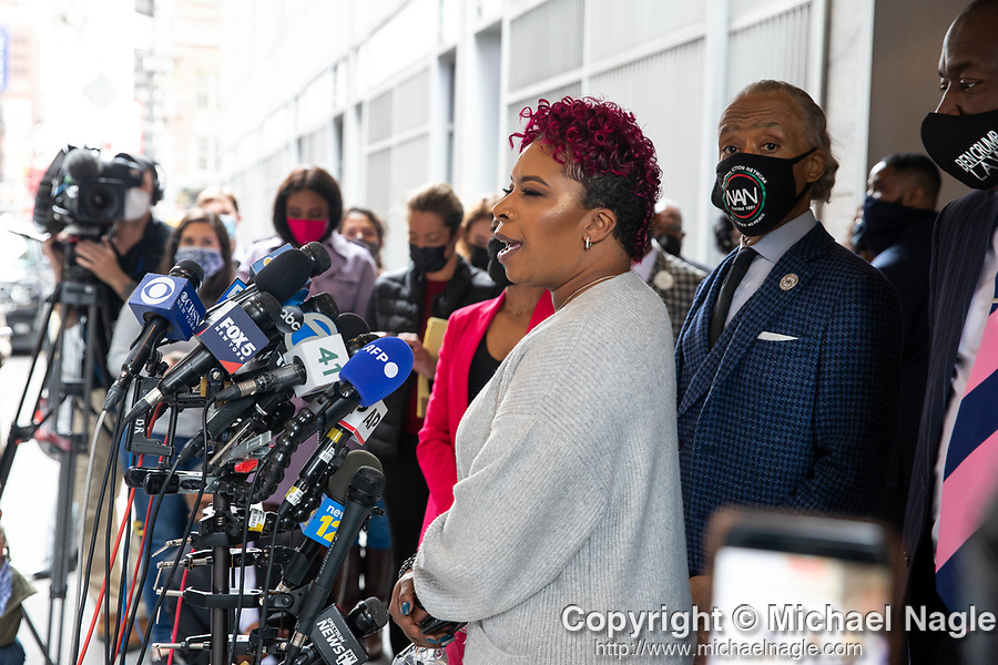 """Lesley McSpadden, mother of Michael Brown, center, speaks at a press conference in response to the George Floyd and Duante Wright cases along with Reverend Al Sharpton right of center, Benjamin Crump, attorney for the family of Duante Wright, right, and members of the """"Mother's of the Movement"""" during the National Action Network (NAN) Virtual Convention 2021 in New York on Wednesday, April 14, 2021. Photograph by Michael Nagle"""