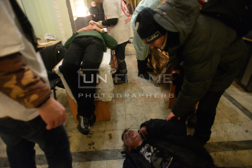 Medical staff and surgeons  treat some of about 200 injuried demonstrators using improvised operating tables during the  protest against new draconian law to ban the right to  protest across the country.  Kiev. Ukraine