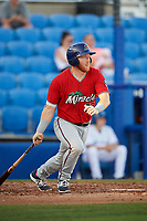 Fort Myers Miracle catcher Taylor Grzelakowski (22) follows through on a swing during a game against the Dunedin Blue Jays on April 17, 2018 at Dunedin Stadium in Dunedin, Florida.  Dunedin defeated Fort Myers 5-2.  (Mike Janes/Four Seam Images)