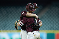Mississippi State Bulldogs relief pitcher Cole Gordon (24) gets a hug from catcher Dustin Skelton (8) after the final out against the Louisiana Ragin' Cajuns in game three of the 2018 Shriners Hospitals for Children College Classic at Minute Maid Park on March 2, 2018 in Houston, Texas.  The Bulldogs defeated the Ragin' Cajuns 3-1.   (Brian Westerholt/Four Seam Images)