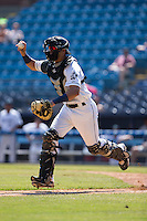 Asheville Tourists catcher Dom Nunez (9) chases a runner back towards third base during the game against the Rome Braves at McCormick Field on July 26, 2015 in Asheville, North Carolina.  The Tourists defeated the Braves 16-4.  (Brian Westerholt/Four Seam Images)