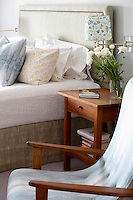 Modern bed and wooden nightstand