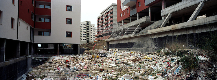 Rubbish dumped near construction work on a hill overlooking Prishtina. The post war building boom that no one can really explain in Europe's poorest country continues apace. The latest project under construction is Kosovo's very own World Trade Centre, which promises to be the tallest building in the Balkans.