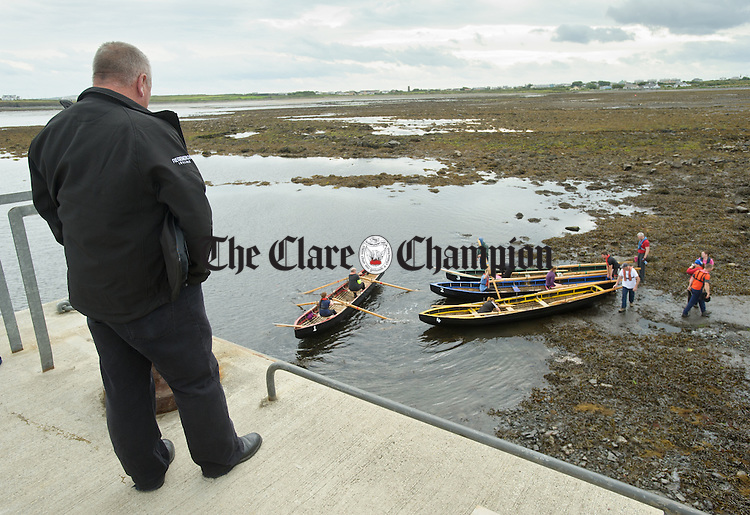 Competitors get into the boats before competing at the All-Ireland  Currach Regatta at Doonbeg. Photograph by John Kelly.