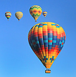 Hot Air Balloons sailing over Napa Valley, CA.