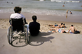 Wheelchair user on a visit to a seaside resort