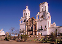 """Mission San Xavier del Bac (""""""""The White Dove of the Desert"""""""") was built in 1783-1797 by Franciscan missionaries. Since 1911, it has been maintained as the main church and school of the Tohono O'Odham Indian Reservation. Tucson Arizona USA."""