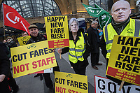 The RMT and TSSA rade unions join passenger groups outside Kings Cross station for a protest over rail fares increase of 3.1%. London 2-1-19