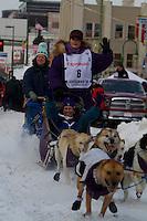 2010 Iditarod Ceremonial Start in Anchorage Alaska musher # 6 JESSIE ROYER with Iditarider CAROLYN BARRETT