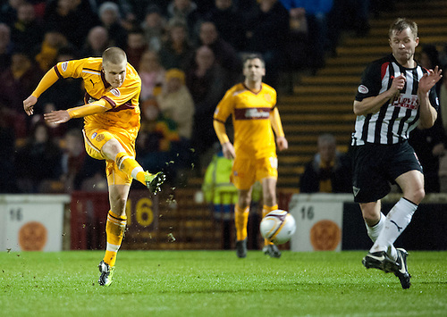 PICTURE BY - ROB CASEY .DESCRIPTION - MOTHERWELL v DUNFERMLINE.PIC SHOWS - HENRIK OJAMAA SCORES A BELTER OF A GOAL FOR MOTHERWELL AS KEVIN RUTKIEWICZ LOOKS ON…… 1-0.