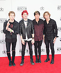 Luke Hemmings, Michael Clifford, Calum Hood and Ashton Irwin of 5 Seconds of Summer at The 2014 American Music Award held at The Nokia Theatre L.A. Live in Los Angeles, California on November 23,2014                                                                               © 2014 Hollywood Press Agency