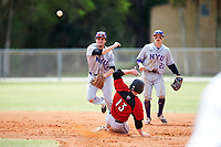 New York University Violets shortstop Jonathan Iaione (2) throws to first as Danny Appino (13) slides in with second baseman Ryan Mclaughlin (21) looking on during a game against the Edgewood Eagles on March 14, 2017 at Terry Park in Fort Myers, Florida.  NYU defeated Edgewood 12-7.  (Mike Janes/Four Seam Images)