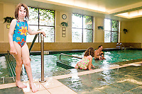 Kathy May at the pool at the Share and Care Network's annual retreat held at the Doubletree Guest Suites Hotel in Boston on May 20, 2006. <br /> <br /> The Share and Care Network was created in 1981 by Pat Cahill when her son Scott was diagnosed with Cockayne Syndrome.  A rare form of dwarfism, Cockayne Syndrome is a genetically determined condition whose symptoms include microcephaly, mental retardation, progressive blindness, progressive hearing loss, premature aging, and a shortened lifespan averaging 18 years.  Those afflicted have distinctive facial features, including sunken eyes, pinched faces, and protruding jaws as well as distinctive gregarious, affectionate personalities.<br /> <br /> Because of the rarity of the condition (1/1,000 live births) and its late onset (characteristics usually begin to appear only after one year), many families and physicians are often baffled by children whose health begins to deteriorate after normal development.  It was partly with this in mind that the Share and Care Network was formed, to promote awareness of this disease as well as to provide a support network for those families affected.  In 1998 it began organizing an annual retreat, which has grown from three families in its inaugural year to more than 30 today.  Although the retreat takes place in the United States, families from as far as Japan arrive for this one weekend out of the year to share information and to support one another.