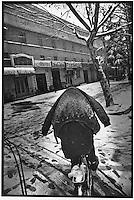 A lone cyclist cycles through a veneer of winter snow...PHOTO BY WANG TONG / SINOPIX