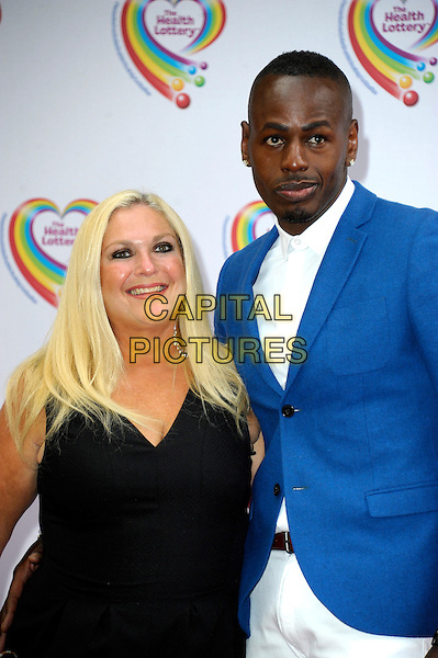 LONDON, ENGLAND - JUNE 02: Vanessa Feltz & Ben Ofoedu attends the Health Lottery Tea Party at The Savoy Hotel on June 2, 2014 in London, England.<br /> CAP/CJ<br /> ©Chris Joseph/Capital Pictures